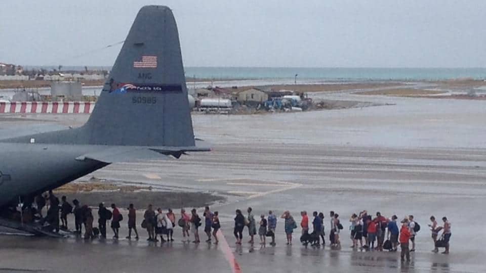 Evacuees leaving the destruction of Hurricane Irma board a WC-130H of the Puerto Rico Air National Guard in St Martin on Saturday.