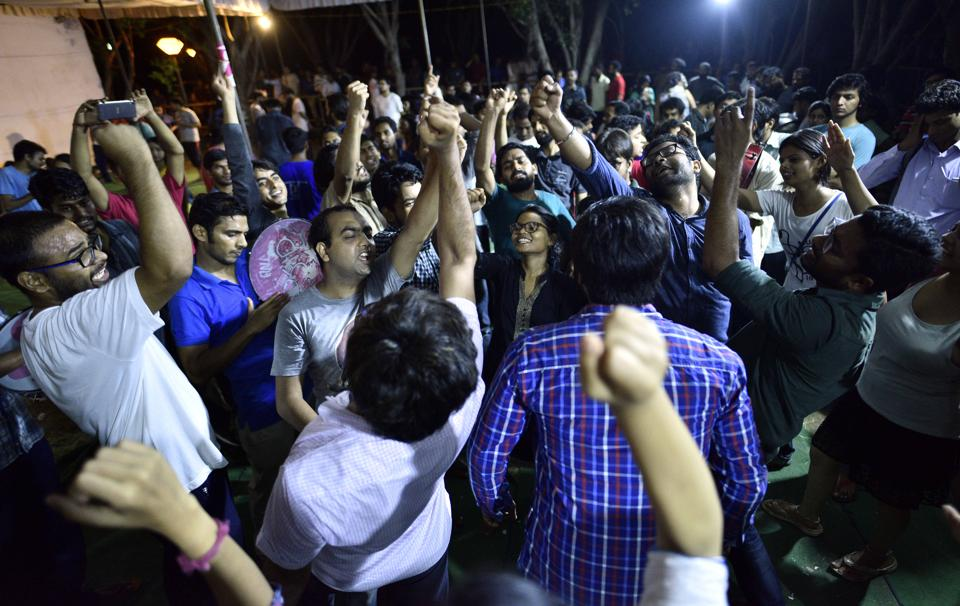 Students and supporters shout slogans during the DUSU elections Counting 2017 at JNU Campus in New Delhi on Saturday.