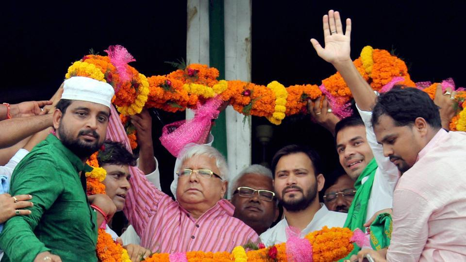 RJD chief Lalu Prasad with leader of opposition in Bihar assembly Tejashwi Yadav being garlanded by