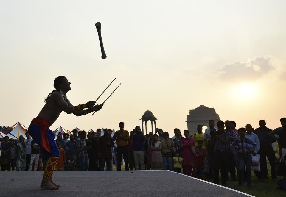 An artist performs during the 'North East Calling festival' at India Gate. The two day festival began on 9th of September in the national capital to promote art, culture, heritage, cuisine, handicrafts, business and tourism of North East India;aiming for socio-economic development of the seven sister states and Sikkim.  (Ravi Choudhary/HT PHOTO)