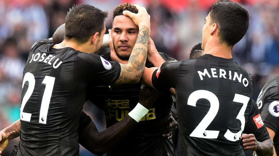 Newcastle United's Jamaal Lascelles celebrates scoring their first goal with teammates.