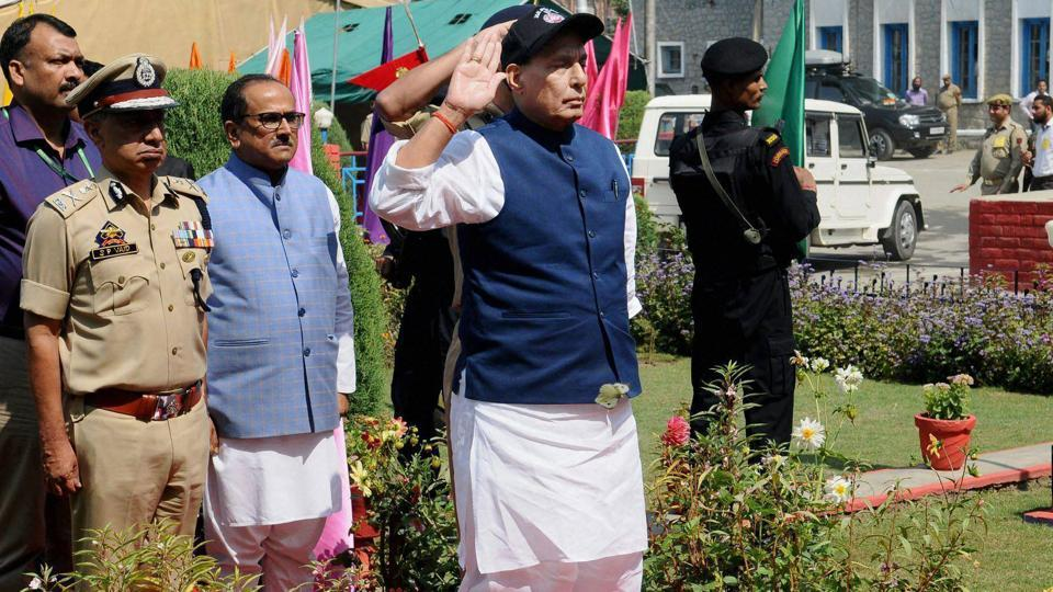 Union home minister Rajnath Singh takes the salute of the Guard of Honour, during his visit to Jammu and Kashmir Police Lines, in Anantnag on Sunday. Jammu and Kashmir deputy chief minister  Nirmal Kumar Singh and DGP, Dr SP Vaid are also seen.