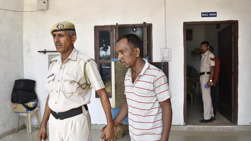 Ashok ,  a bus conductor accused of murdering an eight-year-old boy of Ryan International School in Bhondsi  in police custody at Sona, in Gurgaon. His victim's father suspects the murder was planned.