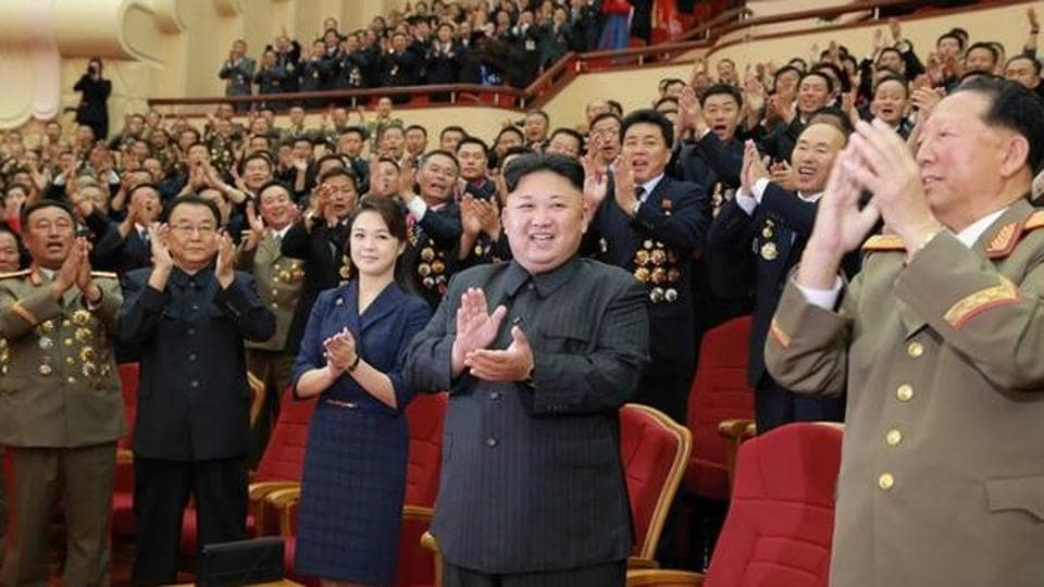A photo released by North Korea's Central News Agency shows leader Kim Jong-un celebrating with nuclear scientists and engineers who contributed to a hydrogen bomb test, in Pyongyang.