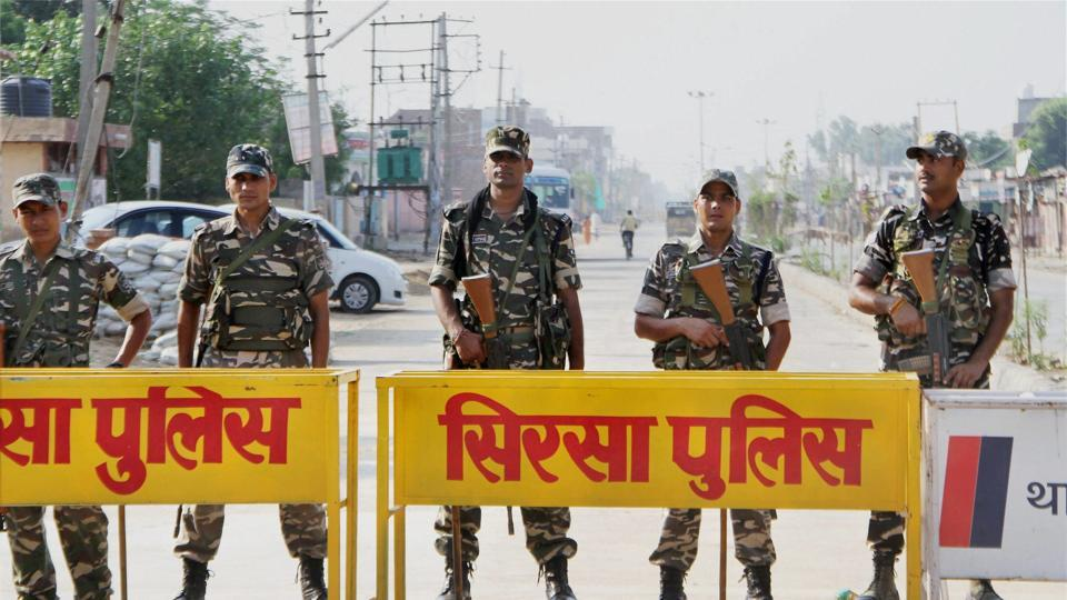 Security personnel stand guard during the third day of search operation at the Dera Sacha Sauda in Sirsa on Sunday.