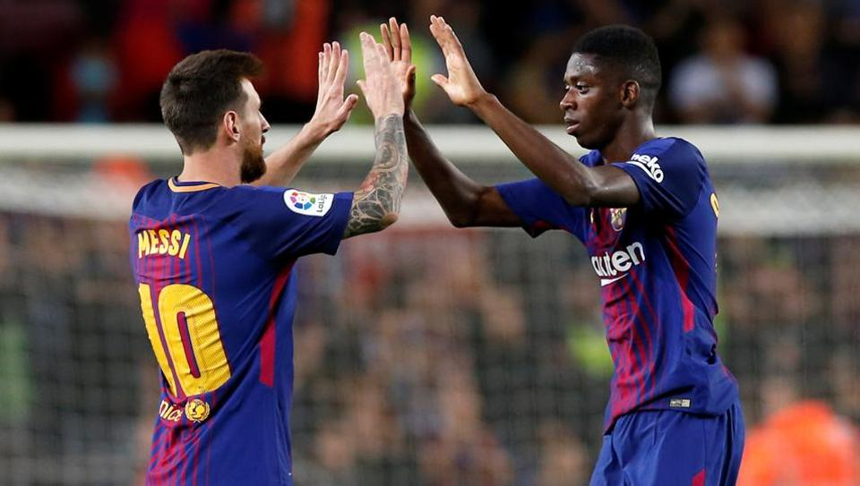 Lionel Messi and Ousmane Dembele celebrate after beating Espanyol 5-0 in their La Liga encounter.