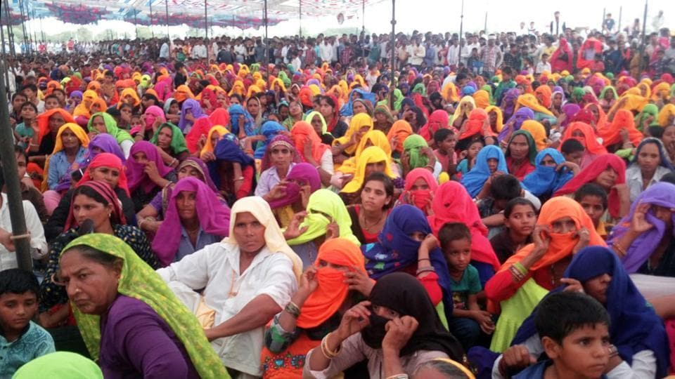 People take part in a meeting to decide on alcohol ban, in Bharatpur on Sunday.