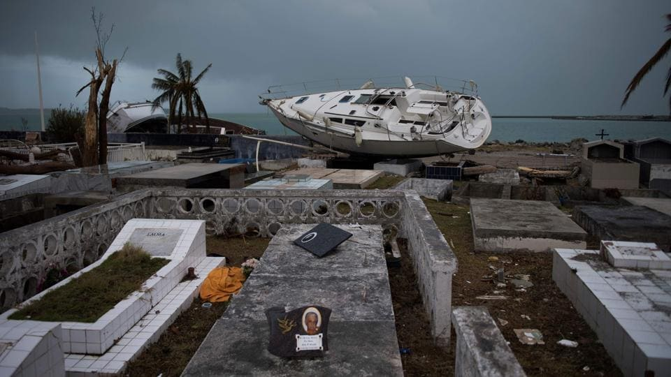 A sailing boat is beached in the cemetery of Marigot, on September 9, 2017 in Saint-Martin island devastated by Irma hurricane. From the devastating hurricane Irma to the mass migration of Rohingya refugees, photos of the week from around the world.  (Martin Bureau / AFP)