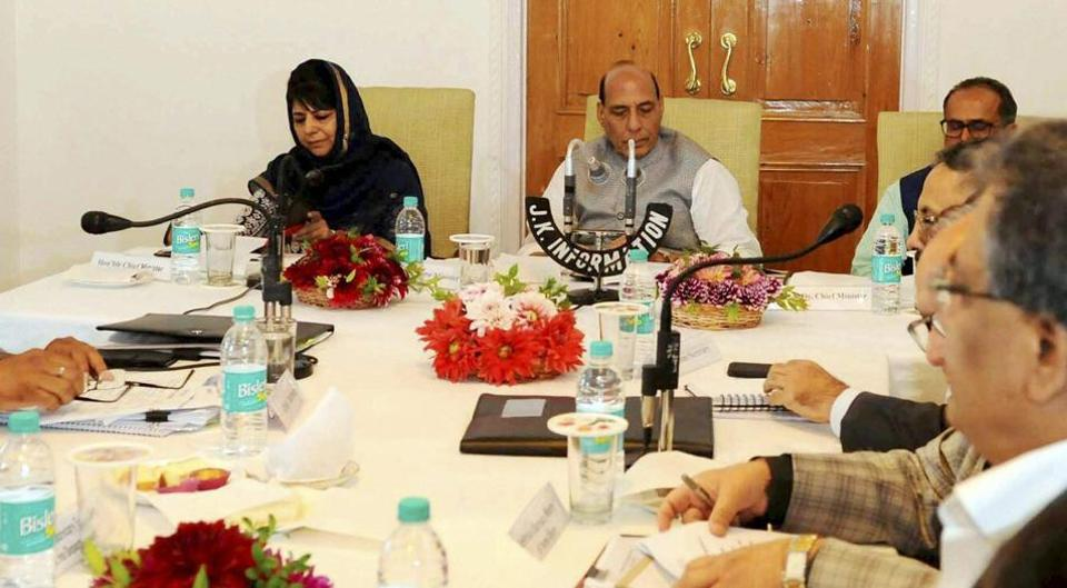 Union Home Minister Rajnath Singh along with Jammu and Kashmir Chief Minister Mehbooba Mufti and Deputy Chief Minister Nirmal Kumar Singh, State's Chief Secretary, B.B. Vyas with senior officials reviewing the status of implementation of the Prime Minister's Development Package (PMDP-2015) in Srinagar on Saturday.