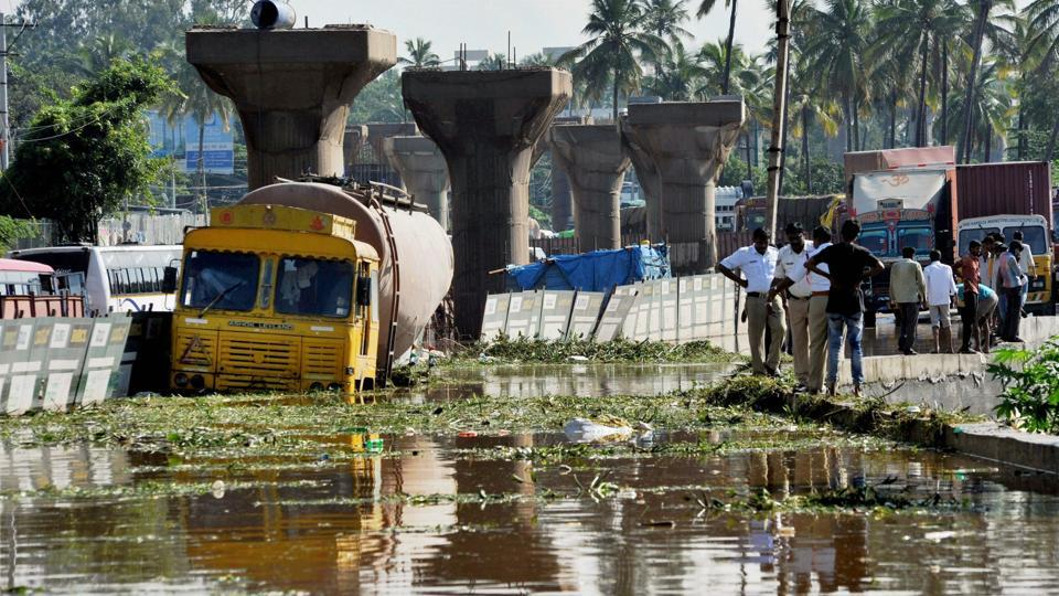 A lorry stuck at a waterlogged road near the metro construction site in Kengeri in Bengaluru on Sunday following rains.