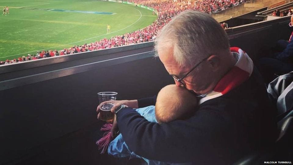 Australian PMMalcolm Turnbull posted a picture of him having a beer while holding his granddaughter.