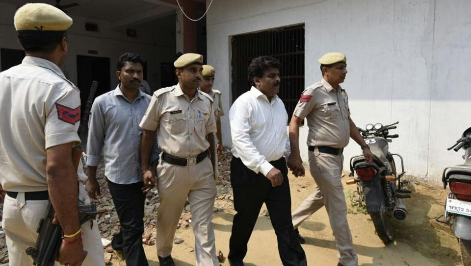 Regional head of Ryan Group of Institutions Francis Thomas (in white shirt) and HR head Jeyus Thomas (grey shirt) at the court premises in Sohna on Monday.