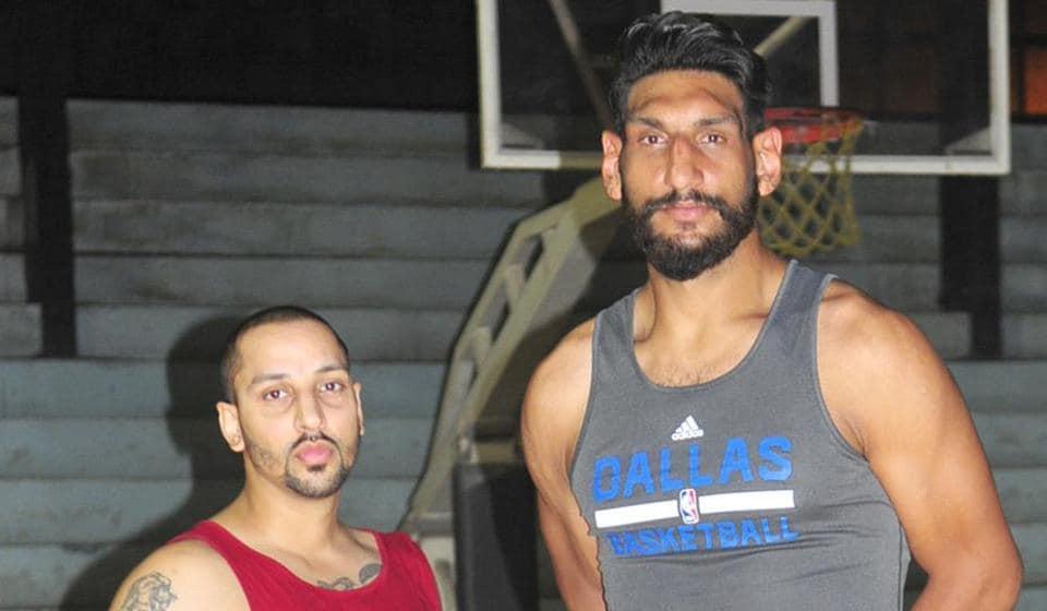 Indian cagers Satnam Singh Bhamara (L) and Talwinderjit Singh Sahi
