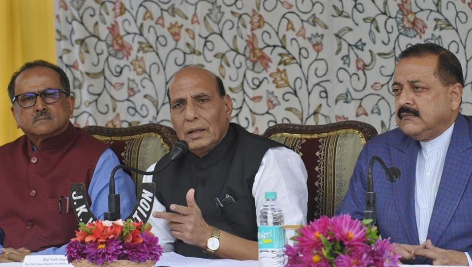 Union home minister Rajnath Singh, along with J-K deputy chief minister Nirmal Singh (left) and Union minister of state in the PMO Jitendra Singh, at a press conference in Srinagar on Monday. (Waseem Andrabi  / HTPhoto)