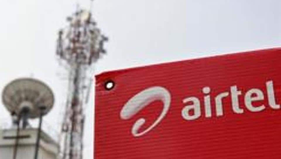 A Bharti Airtel advertisement board is installed against the backdrop of company's telecommunication tower in Kochi.