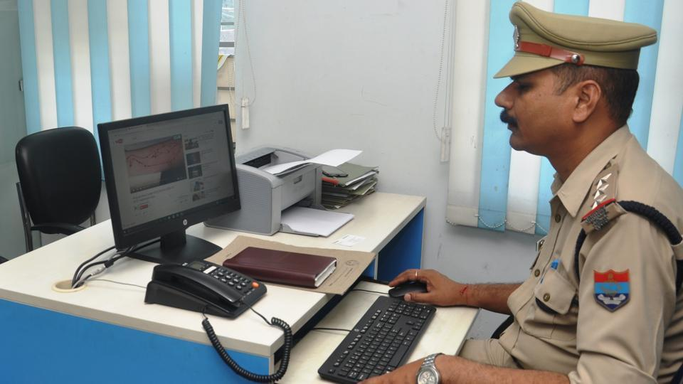 A police officer at cyber crime police station in Dehradun.