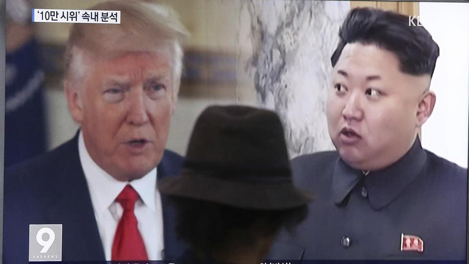 A television screen showing US President Donald Trump and North Korean leader Kim Jong-un at the Seoul Train Station in Seoul, South Korea.