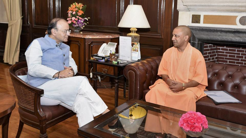 Finance minister Arun Jaitley (L) with Uttar Pradesh chief minister Yogi Adityanath during a meeting in New Delhi on Monday.