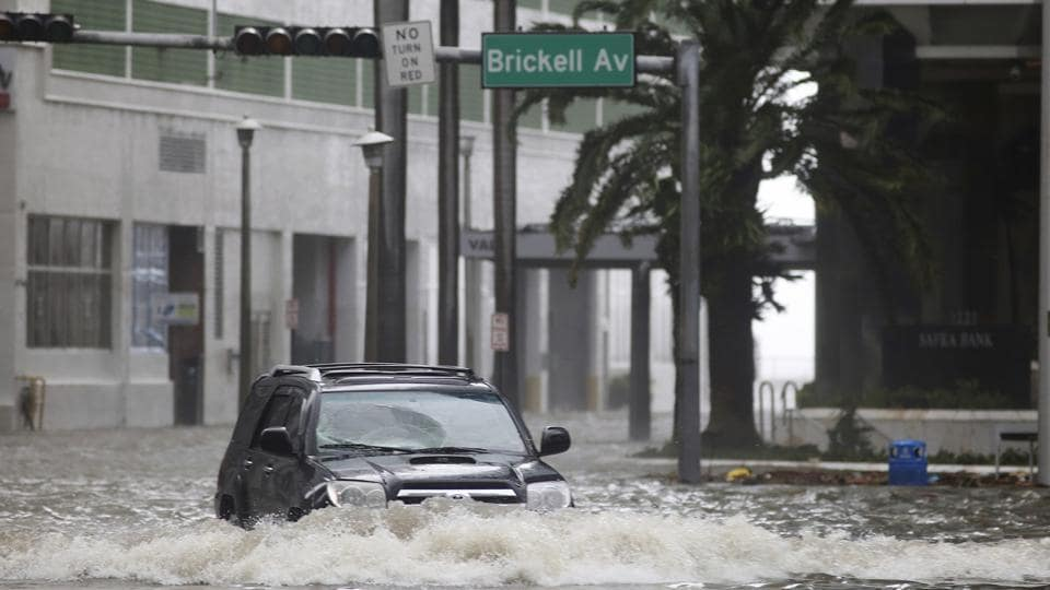 A vehicle drives on flooded Brickell Avenue in Miami on Sunday as Hurricane Irma passes.