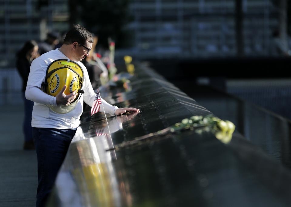 James Taormina, whose brother Dennis Taormina was killed during the September 11 attacks stands by the side of the north waterfall pool before the ceremony at ground zero in New York. During the attacks on September 9, 2001, a group of terrorists affiliated to al-Qaeda hijacked four American airliners with the intention of crashing them into targets. Two planes were flown into the twin towers of the World Trade Center in New York and another was used to target the Pentagon.  (Seth Wenig / AP)