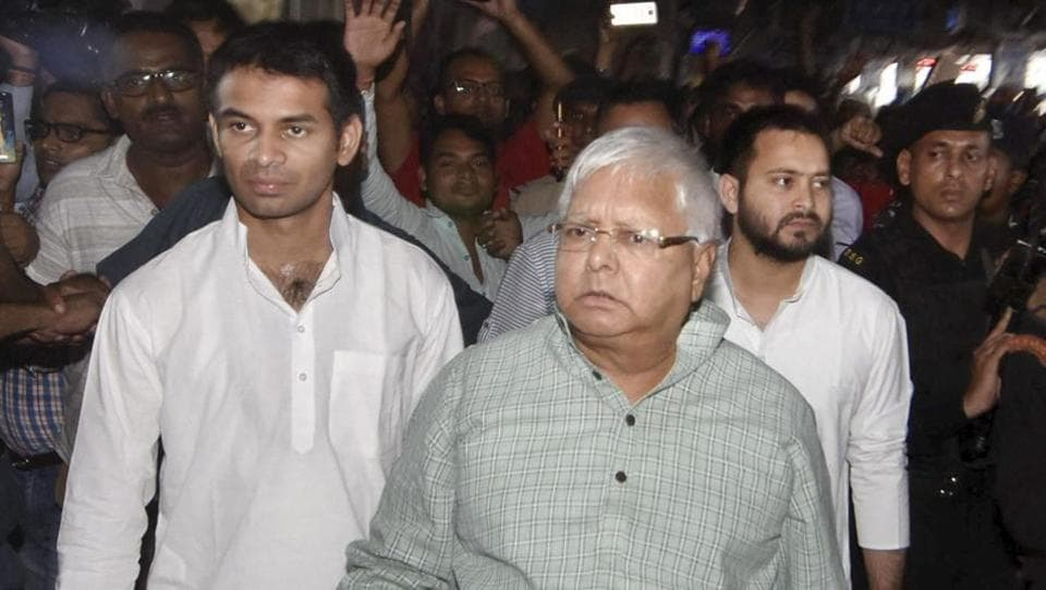 RJD chief Lalu Prasad with his son and leader of opposition Tejashwi Yadav on the way Bhagalpur, in Patna on Saturday.