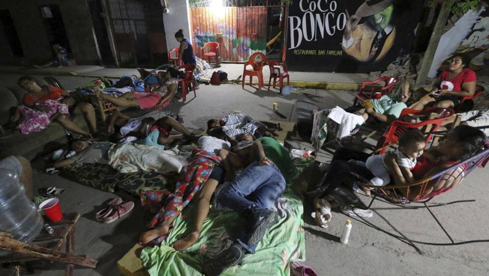 Residents in many areas slept on the streets fearful of more collapses as strong aftershocks continued, including a magnitude 5.2 jolt early Sunday in the aftermath of the earthquake which toppled hundreds of buildings in several states. Hardest-hit was Juchitan, where a third of the city's homes collapsed or were uninhabitable. Some tremors prompted rescue workers to pause in their labour. (Luis Alberto Cruz / AP)