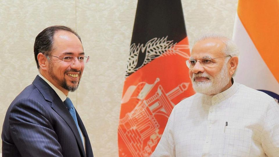 Prime Minister Narendra Modi (L) with foreign minister of Afghanistan, Salahuddin Rabbani, in a meeting in New Delhi on Monday.