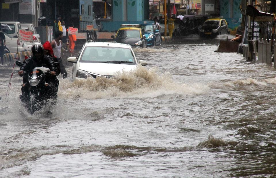 Motorists wade through waterlogged streets of Hindmata in August.