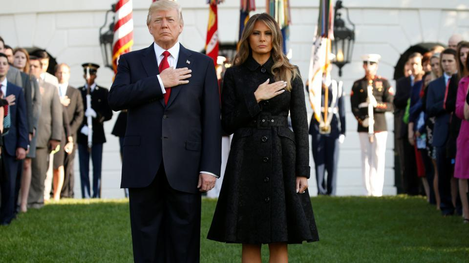 US President along with the first lady Melina Trump observed a moment of silence, first at the White House and later at the Pentagon. The White House commemoration took place at the same at New York's 9/11 memorial on Monday at 08:46 local time (12:46 GMT) to mark the exact time the first plane struck the World Trade Center's North Tower. After the names are read at that ceremony, there's a public observance, with a wreath-laying and remarks. (Kevin Lamarque / REUTERS)