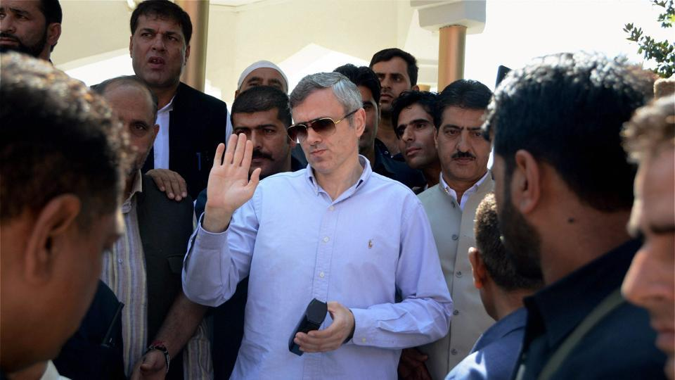 Former chief minister and National Conference working president Omar Abdullah interacts with party supporters after offering special prayers at the graveyard of his grandfather and National Conference founder,in Srinagar.