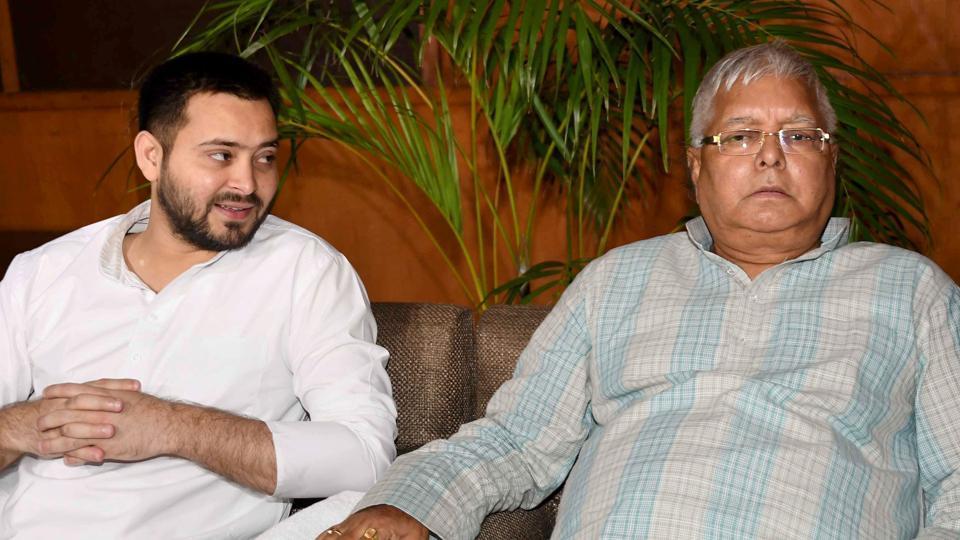 Rashtriya Janata Dal chief Lalu Prasad with his son and Bihar deputy chief minister Tejashwi Yadav in Patna.