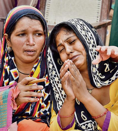 The accused's wife Mamta (right) at her home in Ghamroj village on Monday.