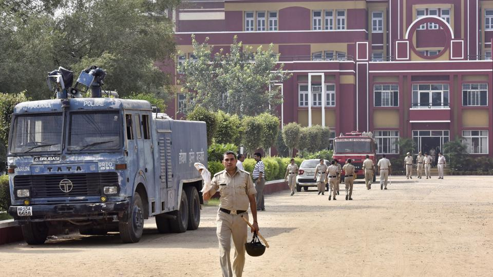 Police personnel at Ryan International School in Bhondsi, Gurgaon.