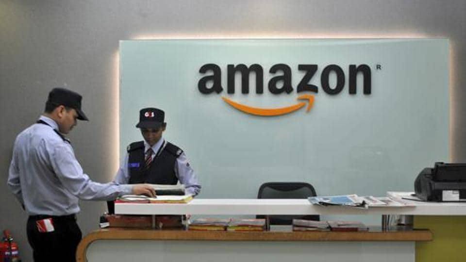 Security guards stand at the reception desk of the Amazon India office in Bengaluru.