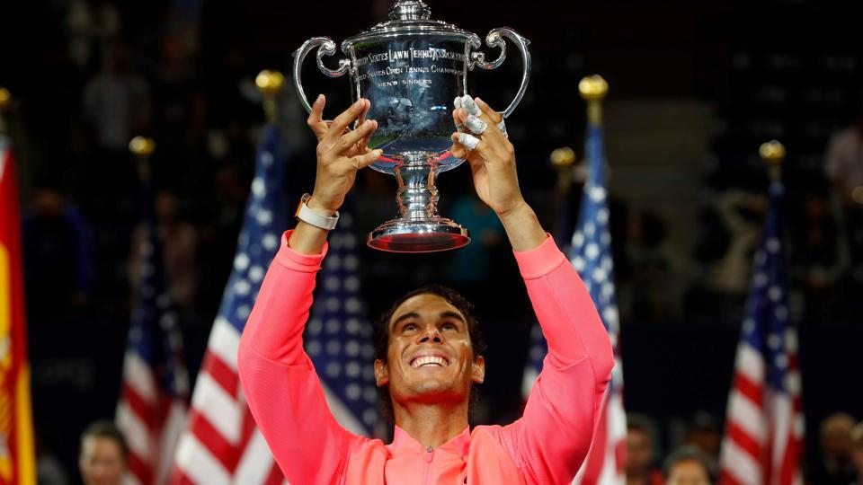 Rafael Nadal holds the USOpen men's singles trophy after defeating Kevin Anderson on Sunday