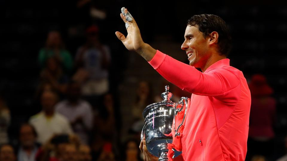 Rafael Nadal holds the USOpen trophy after defeating Kevin Anderson in the men's singles final.