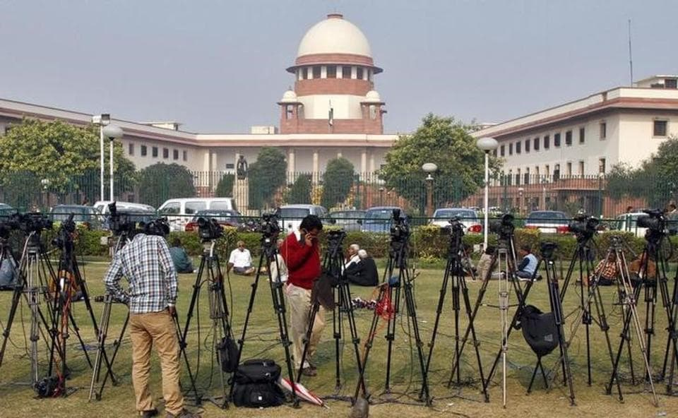 Tripods of television crew stand in front of the Indian Supreme Court building in New Delhi.