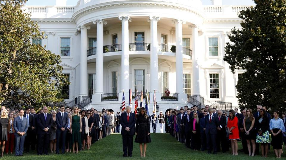US President Donald Trump and first lady Melania Trump observe a moment of silence in remembrance of those lost in the 9/11 attacks at the White House in Washington.