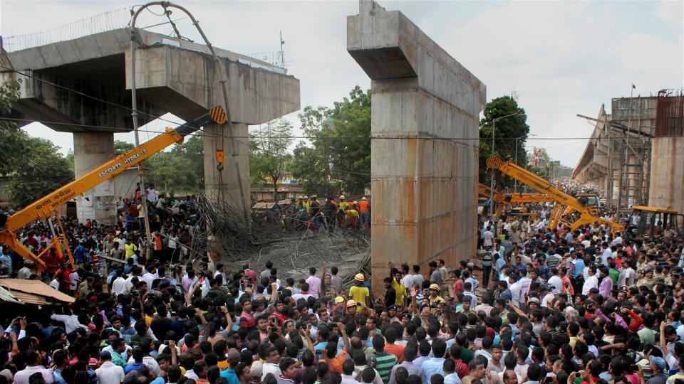 People gather near the site of mishap where an under-construction ovebridge collapsed at Bomikhal in Bhubaneswar on Sunday.