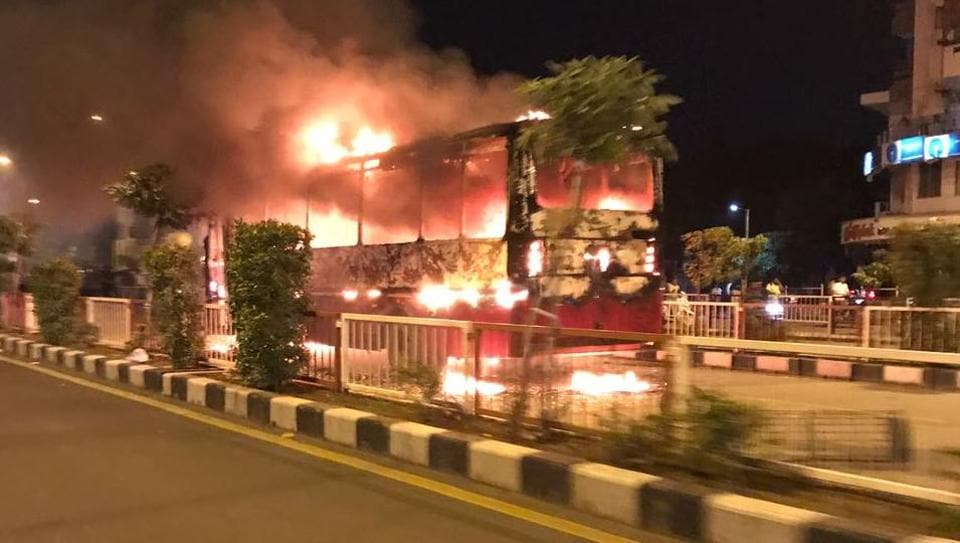 One of the buses set afire by Patidar protesters in Surat.