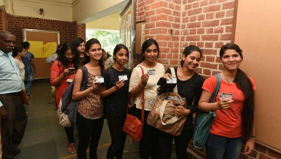 Students queue up to cast their vote for DUSU election at Miranda House college in North Campus in New Delhi.
