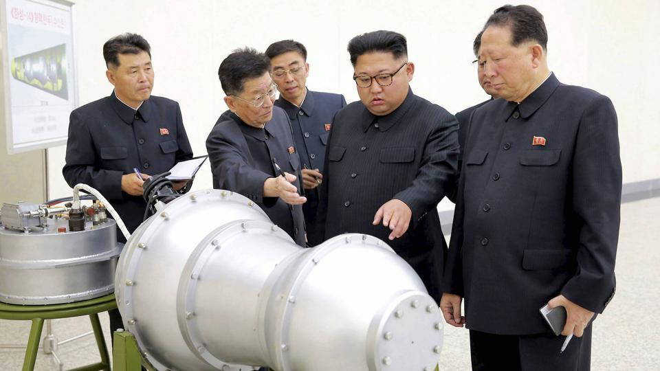 This undated file photo distributed on Sept. 3, 2017, by the North Korean government, shows North Korean leader Kim Jong Un, second from right, at an undisclosed location in North Korea.
