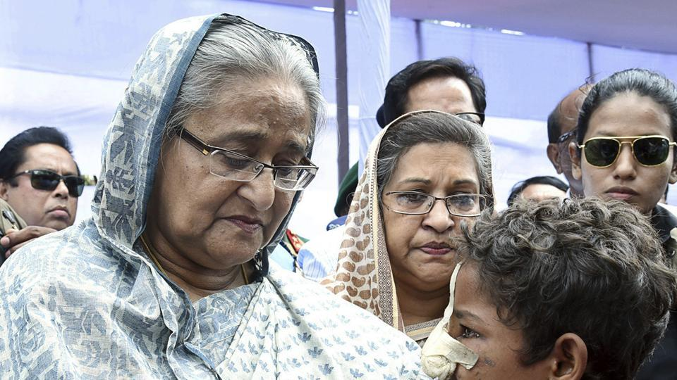 Bangladeshi Prime Minister Sheikh Hasina meets with a Rohingya Muslim child at Kutupalong refugee camp, near the border town of Ukhia, Bangladesh on Tuesday.