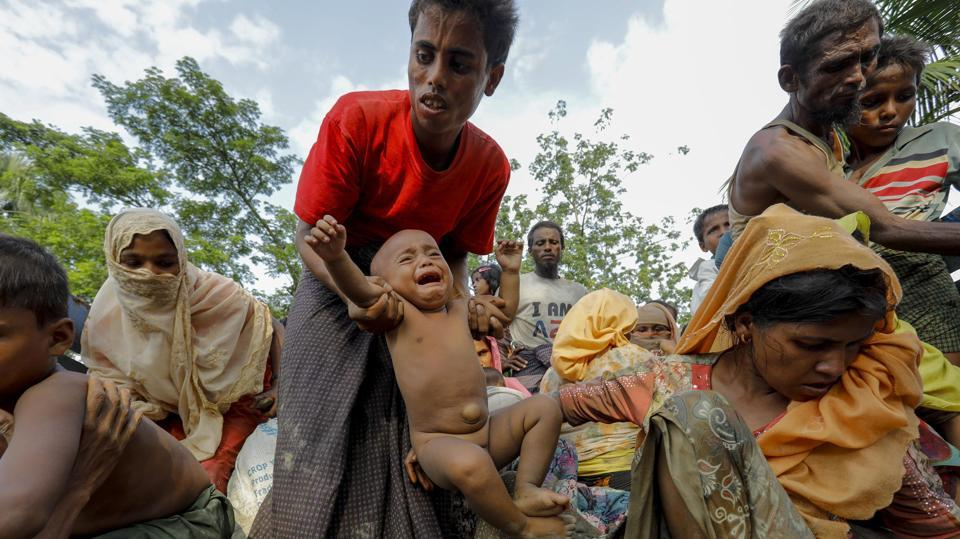 This photo taken on September 5 shows Rohingya Muslim refugees from Myanmar arriving at a new camp in Unchiprang near the Bangladeshi border town of Teknaf.