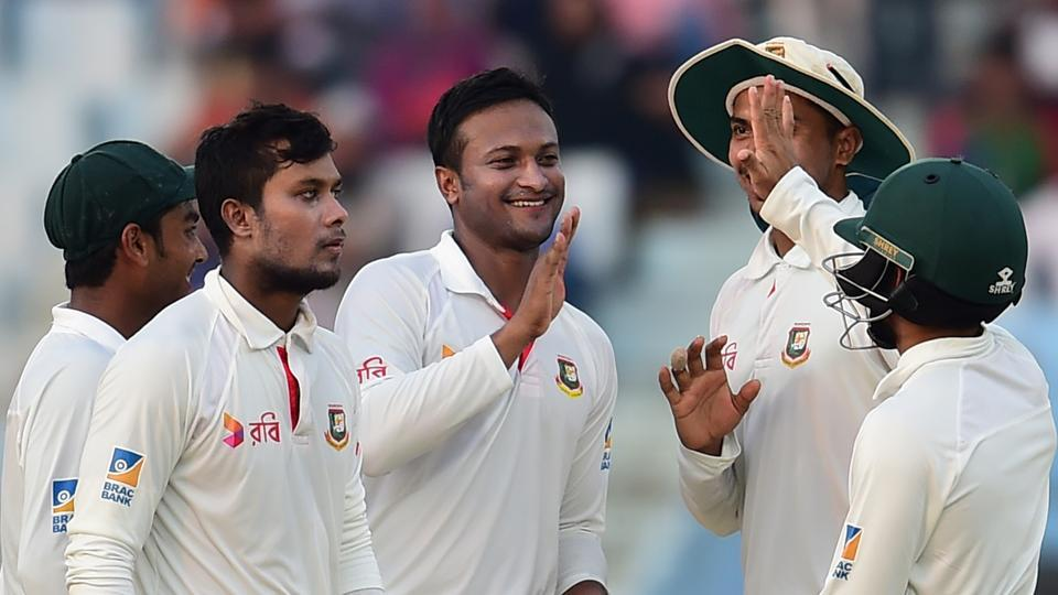 Bangladeshi spinner Shakib Al Hasan (C) celebrates with teammates after the dismissal of Australian batsman Ashton Agar during the third day of the second cricket Test between Bangladesh and Australia at Zahur Ahmed Chowdhury Stadium in Chittagong on September 6, 2017.