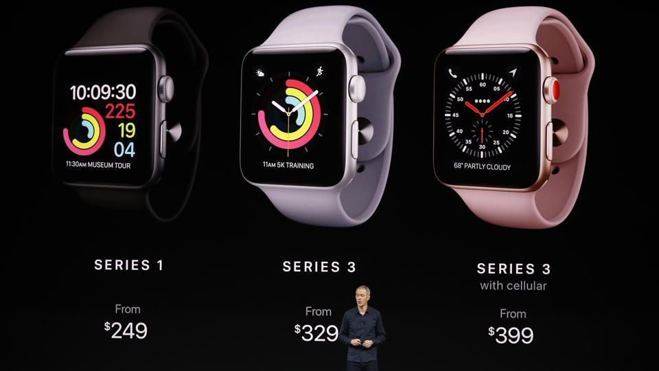 Jeff Williams, Apple COO, speaks as product images are shown behind him during a launch event in Cupertino, California, US on Tuesday.