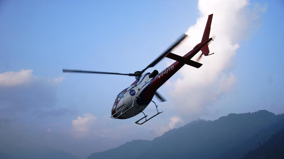 A file photograph of a helicopter flying over the Kedarnath valley in Uttarakhand.
