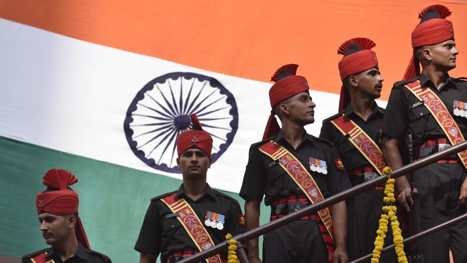 Army personnel posing with Indian National Flag during Independence Day celebration at the Red Fort in New Delhi.