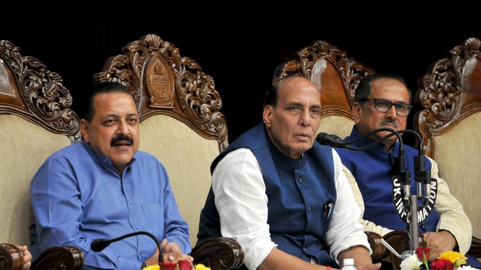 Union Home Minister Rajnath Singh flanked by MoS in PMO Jatinder singh and Jammu and Kashmir Deputy CM  Nirmal Singh addressing a press conference, in Jammu, on Tuesday.