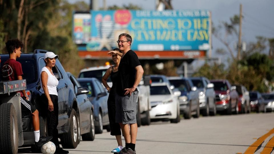 Local residents wait for the reopening of the entry road for the Florida Keys road after Hurricane Irma strikes Florida, in Homestead, Florida, US, on Monday.